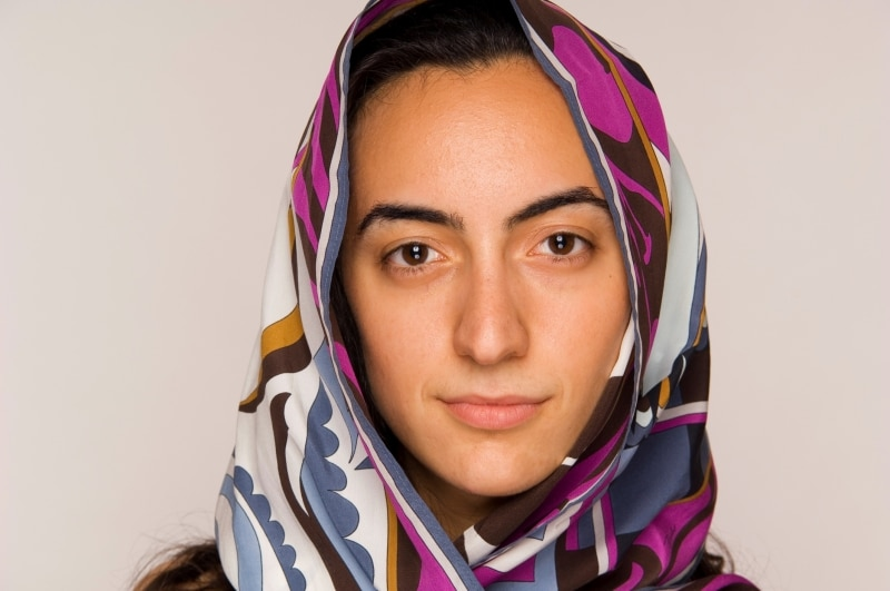 Young middle-eastern woman with head scarf.