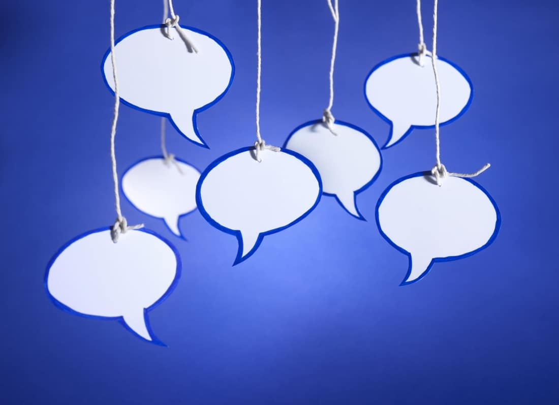 43956647 - multiple speech bubbles cut from card arranged randomly and hanging